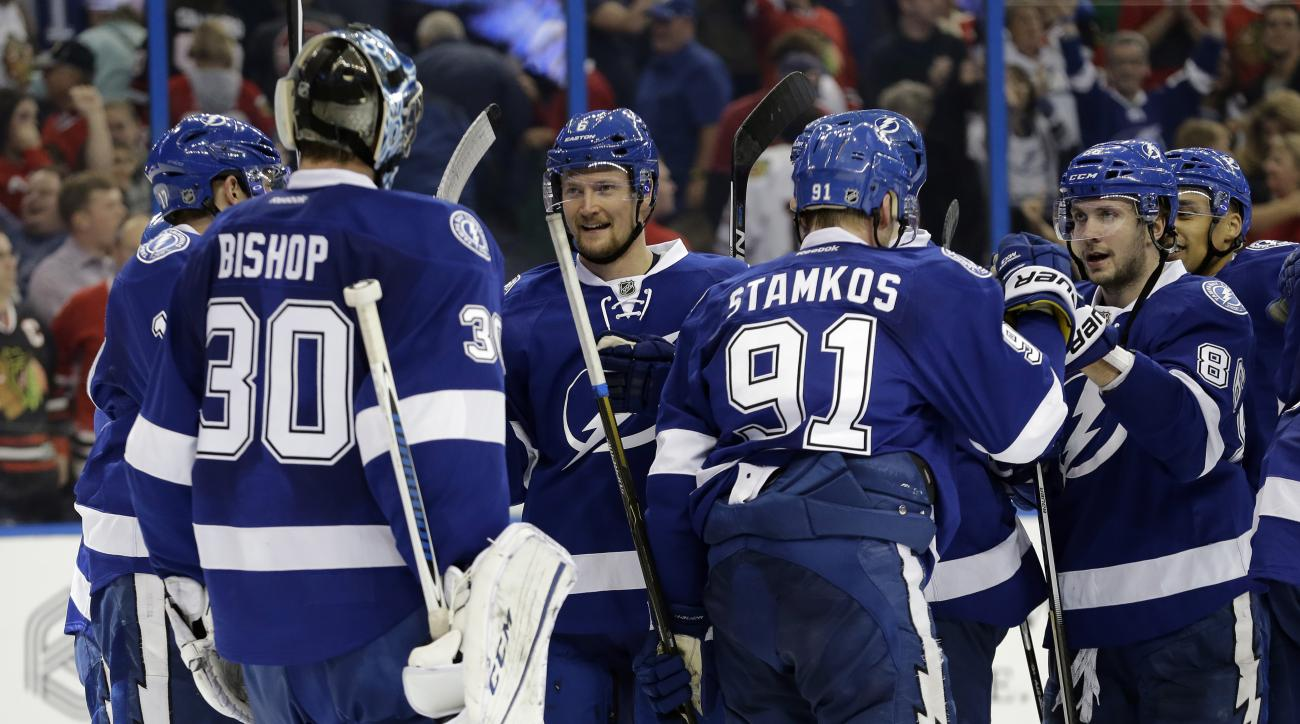 Tampa Bay Lightning goalie Ben Bishop (30) celebrates with teammates after they defeated the Chicago Blackhawks 2-1 during an NHL hockey game, Thursday, Jan. 21, 2016, in Tampa, Fla. (AP Photo/Chris O'Meara)