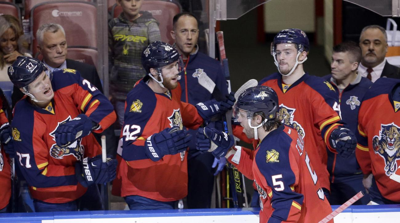 Florida Panthers defenseman Aaron Ekblad (5) is congratulated by teammates after scoring a goal against the Chicago Blackhawks during the second period of an NHL hockey game, Friday, Jan. 22, 2016, in Sunrise, Fla. (AP Photo/Alan Diaz)