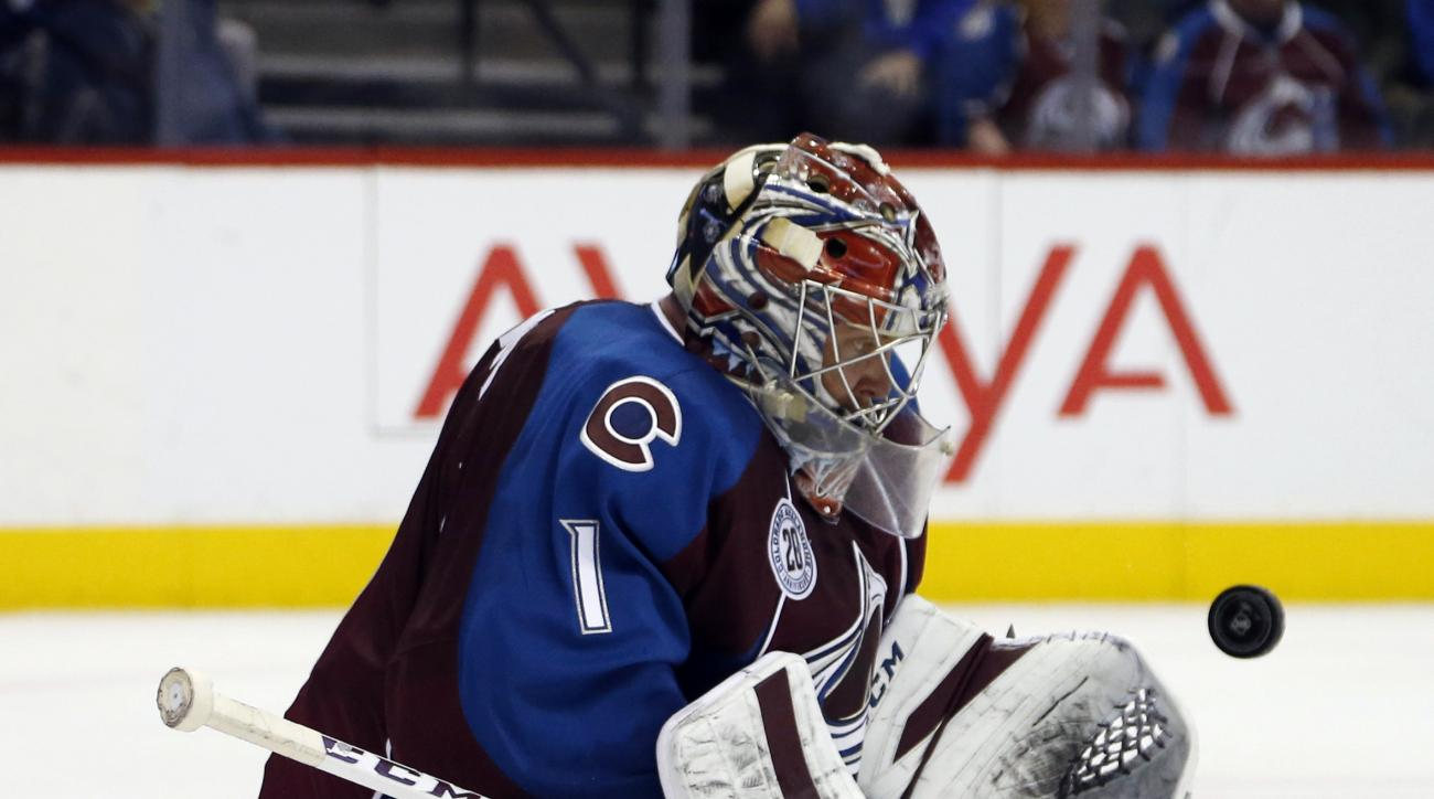 Colorado Avalanche goalie Semyon Varlamov, of Russia, stops a shot off the stick of a St. Louis Blues player in the second period of an NHL hockey game Friday, Jan. 22, 2016, in Denver. (AP Photo/David Zalubowski)