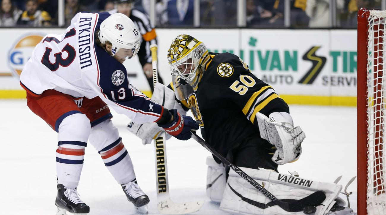 Boston Bruins' Jonas Gustavsson (50) blocks a shot by Columbus Blue Jackets' Cam Atkinson (13) during the shootout in an NHL hockey game in Boston, Saturday, Jan. 23, 2016. The Bruins won 3-2. (AP Photo/Michael Dwyer)