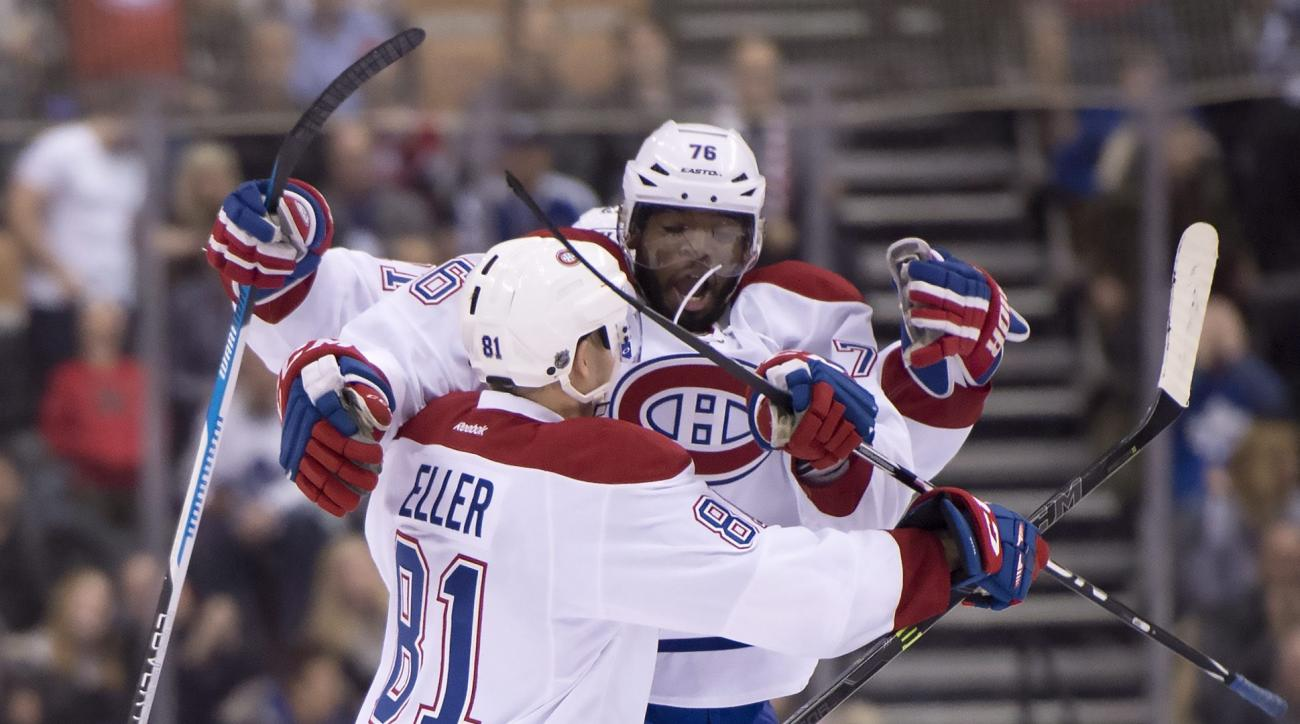 Montreal Canadiens center Lars Eller (81) is congratulated by teammate P.K. Subban after scoring in overtime against the Toronto Maple Leafs during an NHL hockey game in Toronto on Saturday, Jan. 23, 2016. (Frank Gunn/The Canadian Press via AP)