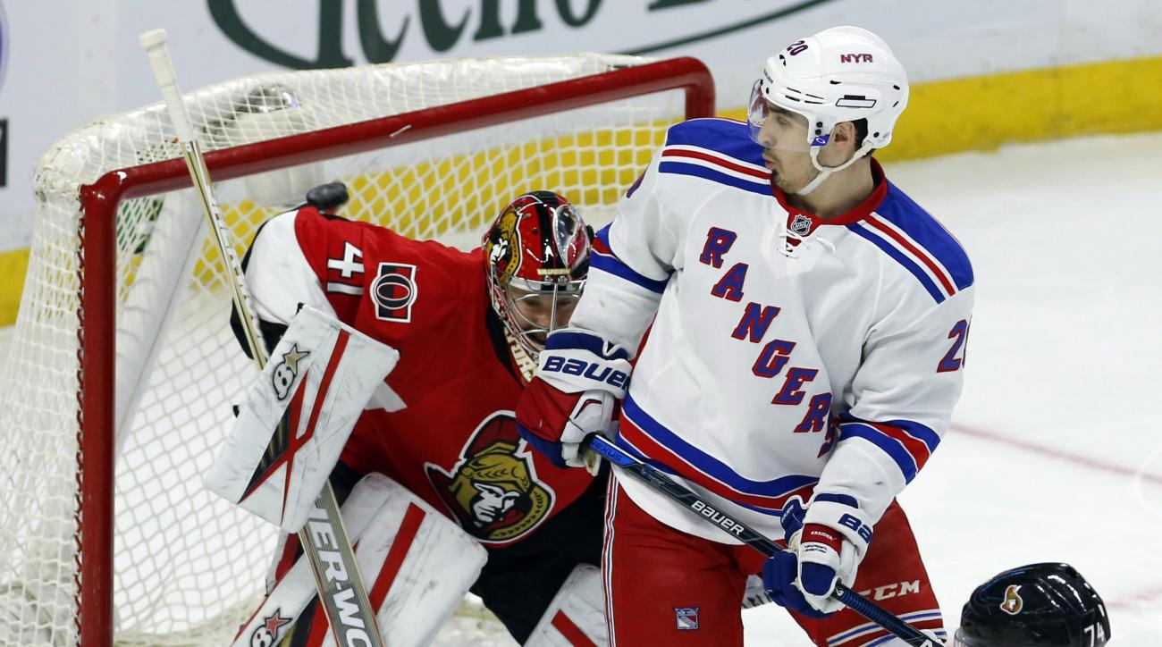 Ottawa Senators Craig Anderson watches as the puck goes off his shoulder as New York Rangers Chris Kreider (20) kooks back during second period NHL hockey action in Ottawa, Ontario, on Sunday, Jan. 24, 2016. (Fred Chartrand/The Canadian Press via AP) MAND