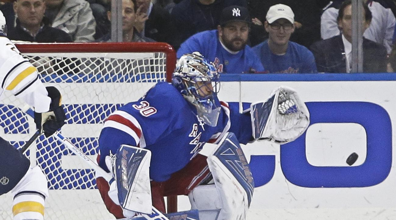 New York Rangers goalie Henrik Lundqvist (30) stops a shot on the goal during the second period of an NHL hockey game against the Buffalo Sabres on Monday, Jan. 25, 2016, in New York. (AP Photo/Frank Franklin II)