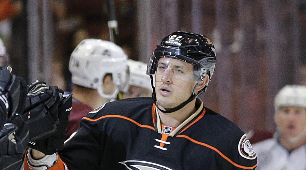 FILE - This is an Oct. 1, 2015, file photo showing Anaheim Ducks' Shawn Horcoff celebrating his goal with teammates during the first period of an NHL preseason hockey game against the Colorado Avalanche, in Anaheim, Calif. Anaheim Ducks forward Shawn Horc