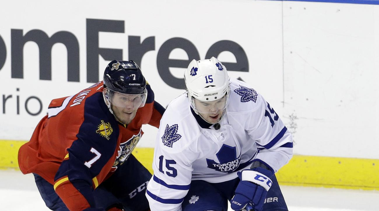 Toronto Maple Leafs right wing P.A. Parenteau (15) skates with the puck as Florida Panthers defenseman Dmitry Kulikov (7) checks Parenteau during the second period of an NHL hockey game, Tuesday, Jan. 26, 2016, in Sunrise, Fla. (AP Photo/Alan Diaz)