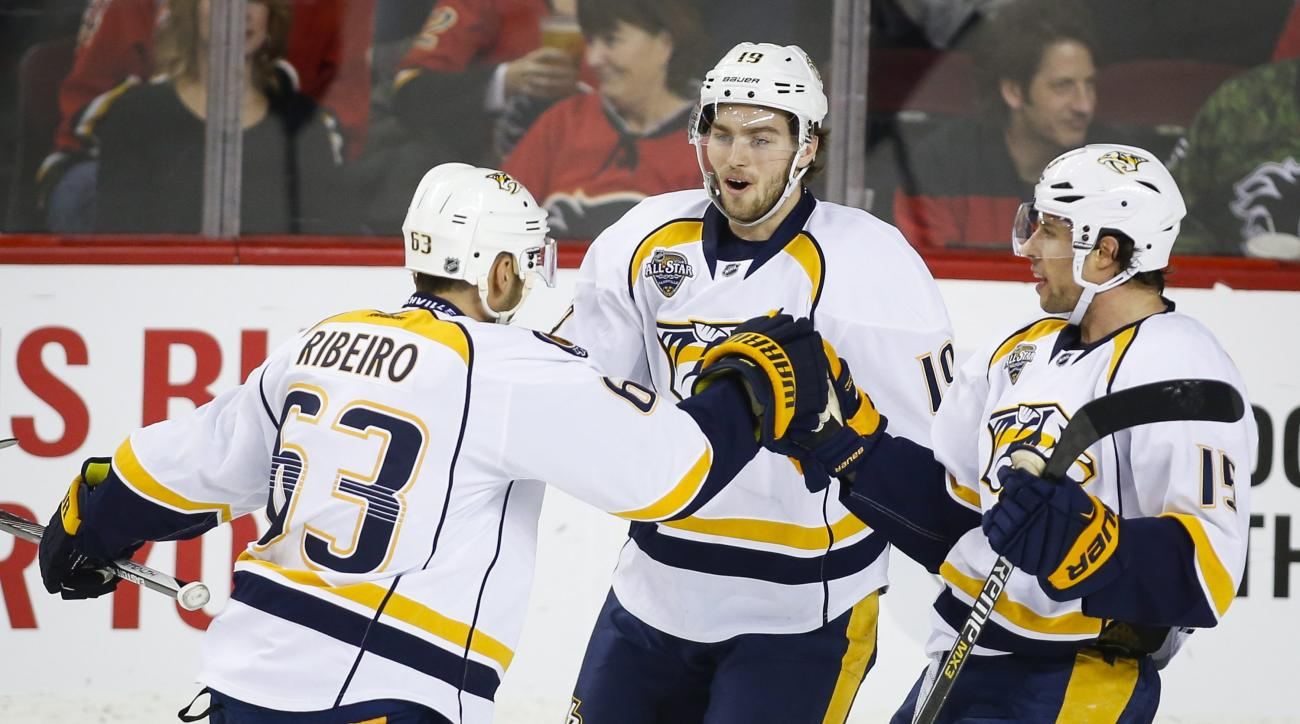 Nashville Predators' Mike Ribeiro, left, celebrates his goal with teammates Calle Jarnkrok, center, of Sweden, and Craig Smith during first period NHL hockey action against the Calgary Flames in Calgary, Alberta, Wednesday, Jan. 27, 2016. (Jeff McIntosh/T