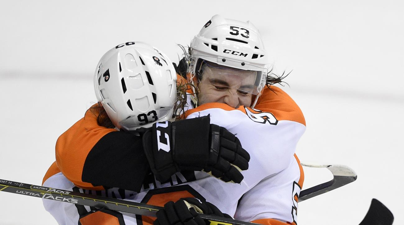 Philadelphia Flyers right wing Jakub Voracek (93), of the Czech Republic, celebrates his game-winning goal in the overtime period of an NHL hockey game with Shayne Gostisbehere (53) against the Washington Capitals, Wednesday, Jan. 27, 2016, in Washington.