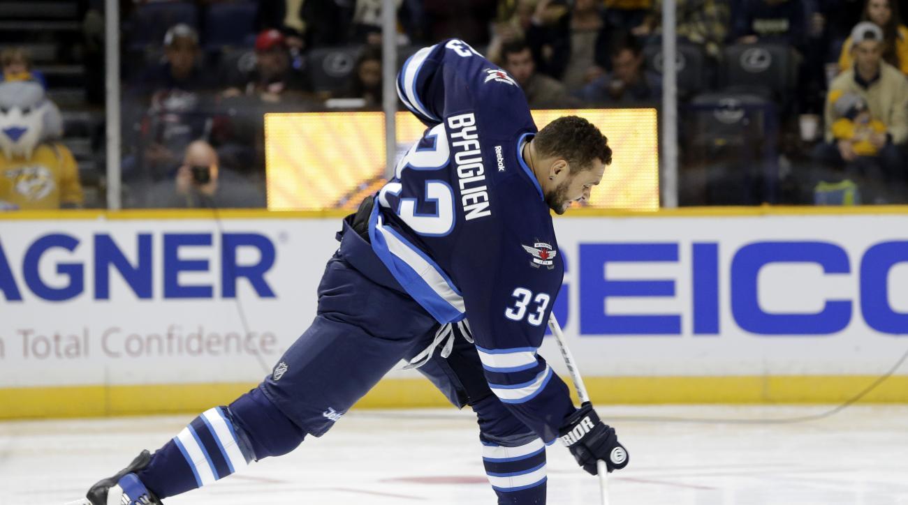 Winnipeg Jets defenseman Dustin Byfuglien (33) competes in the hardest shot competition at the NHL hockey All-Star game skills competition Saturday, Jan. 30, 2016, in Nashville, Tenn. (AP Photo/Mark Humphrey)