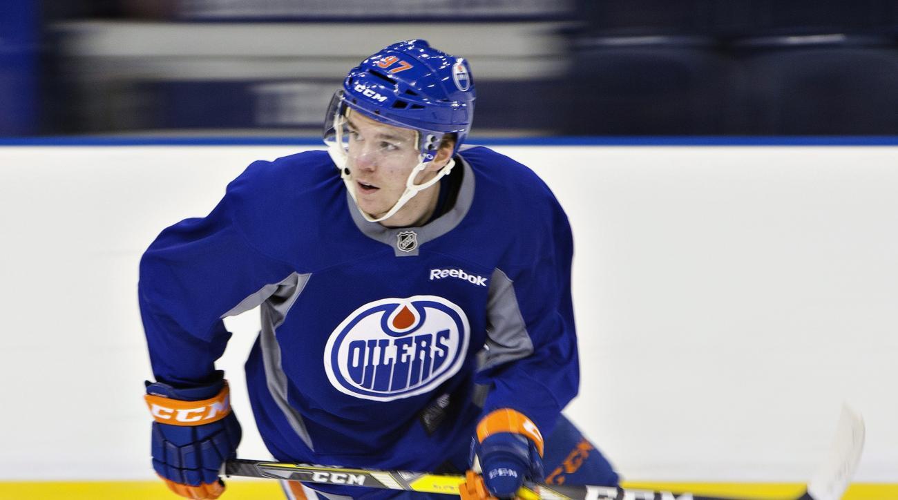 Edmonton Oilers' Connor McDavid skates a drill during NHL hockey practice in Edmonton, Alberta, Monday, Feb. 1, 2016. (Jason Franson/The Canadian Press via AP) MANDATORY CREDIT
