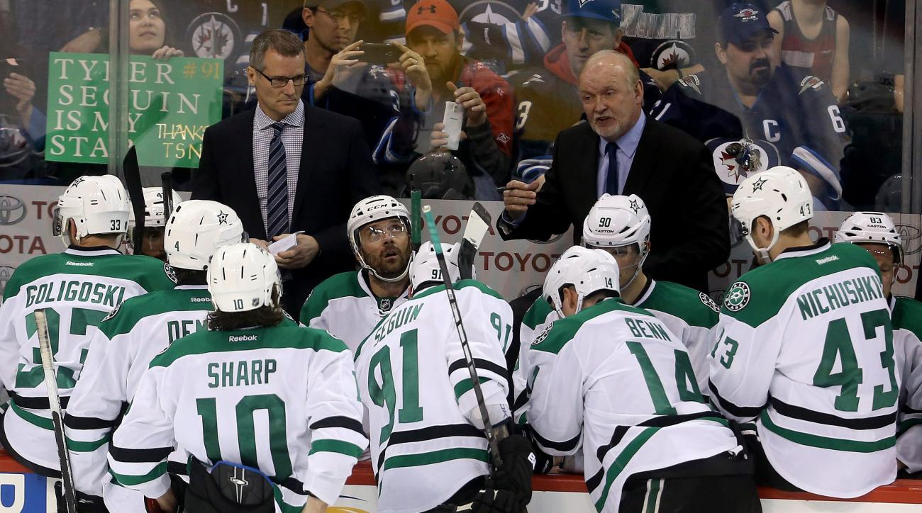 Dallas Stars coach Lindy Ruff gives instructions to his team during the third period of an NHL hockey game against the Winnipeg Jets on Tuesday, Feb. 2, 2016, in Winnipeg, Manitoba. (Trevor Hagan/The Canadian Press via AP)