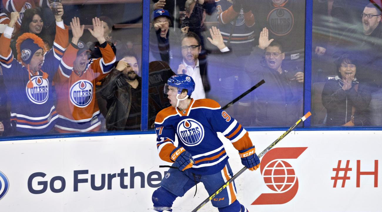 Edmonton Oilers' Connor McDavid (97) celebrates his goal against the Columbus Blue Jackets during the second period of an NHL hockey game in Edmonton, Alberta, Tuesday, Feb. 2, 2016.  (Jason Franson/The Canadian Press via AP) MANDATORY CREDIT