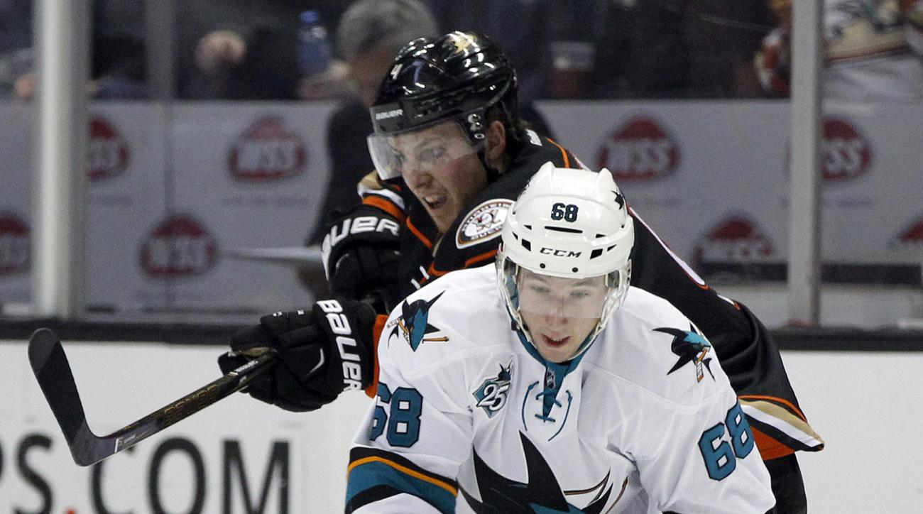 San Jose Sharks right wing Melker Karlsson (68), of Sweden, takes the puck away from Anaheim Ducks defenseman Cam Fowler during the second period of an NHL hockey game in Anaheim, Calif., Tuesday, Feb. 2, 2016. (AP Photo/Alex Gallardo)