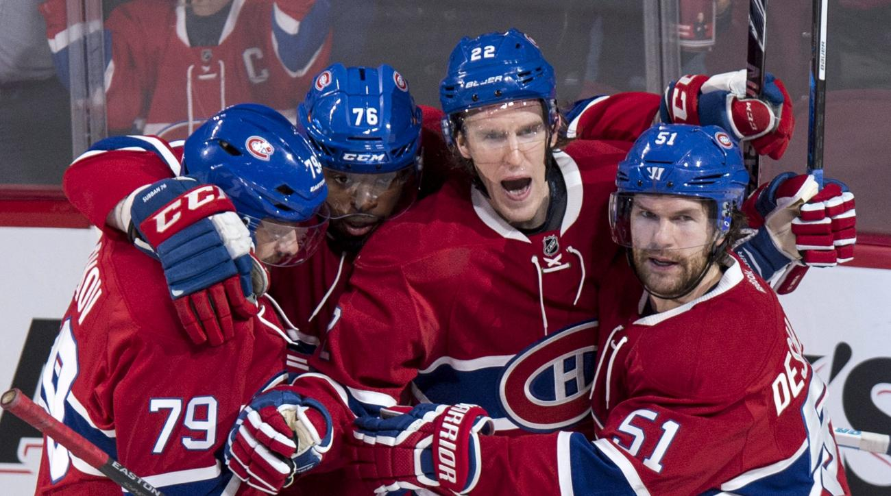 Montreal Canadiens' Dale Weise (22) celebrates his goal against the Buffalo Sabres with teammates Andrei Markov, P.K. Subban and David Desharnais, left to right, during the second period of an NHL hockey game, Wednesday, Feb. 3, 2016 in Montreal. (Paul Ch