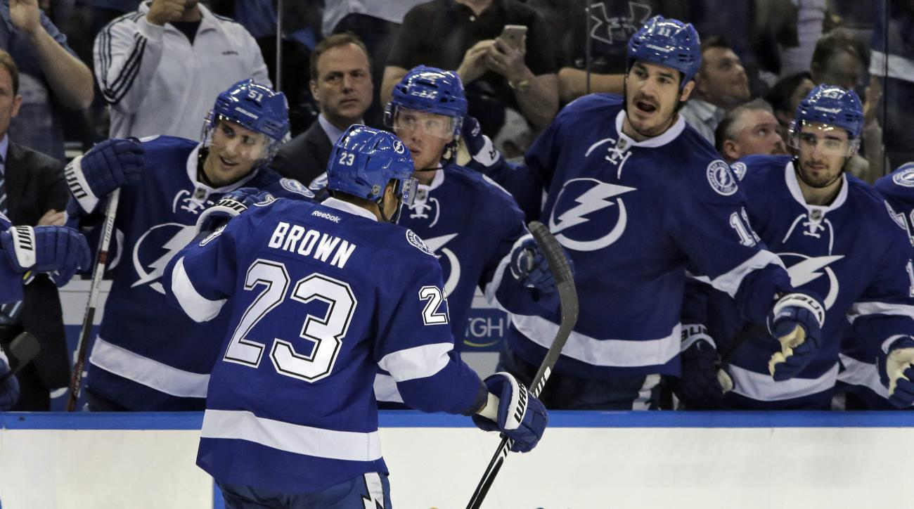 Tampa Bay Lightning right wing J.T. Brown (23) celebrates with teammates after scoring against the Detroit Red Wings during the second period of an NHL hockey game Wednesday, Feb. 3, 2016, in Tampa, Fla. (AP Photo/Chris O'Meara)