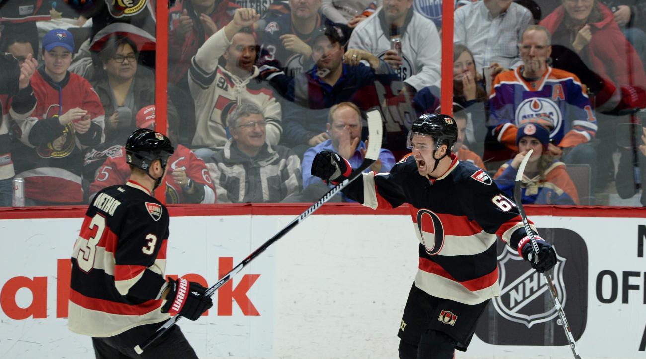 Ottawa Senators' Mark Stone, right, celebrates a goal against the Edmonton Oilers with teammate Marc Methot during the second period of an NHL hockey game, Thursday, Feb. 4, 2016 in Ottawa, Ontario. (Sean Kilpatrick/The Canadian Press via AP) MANDATORY CR