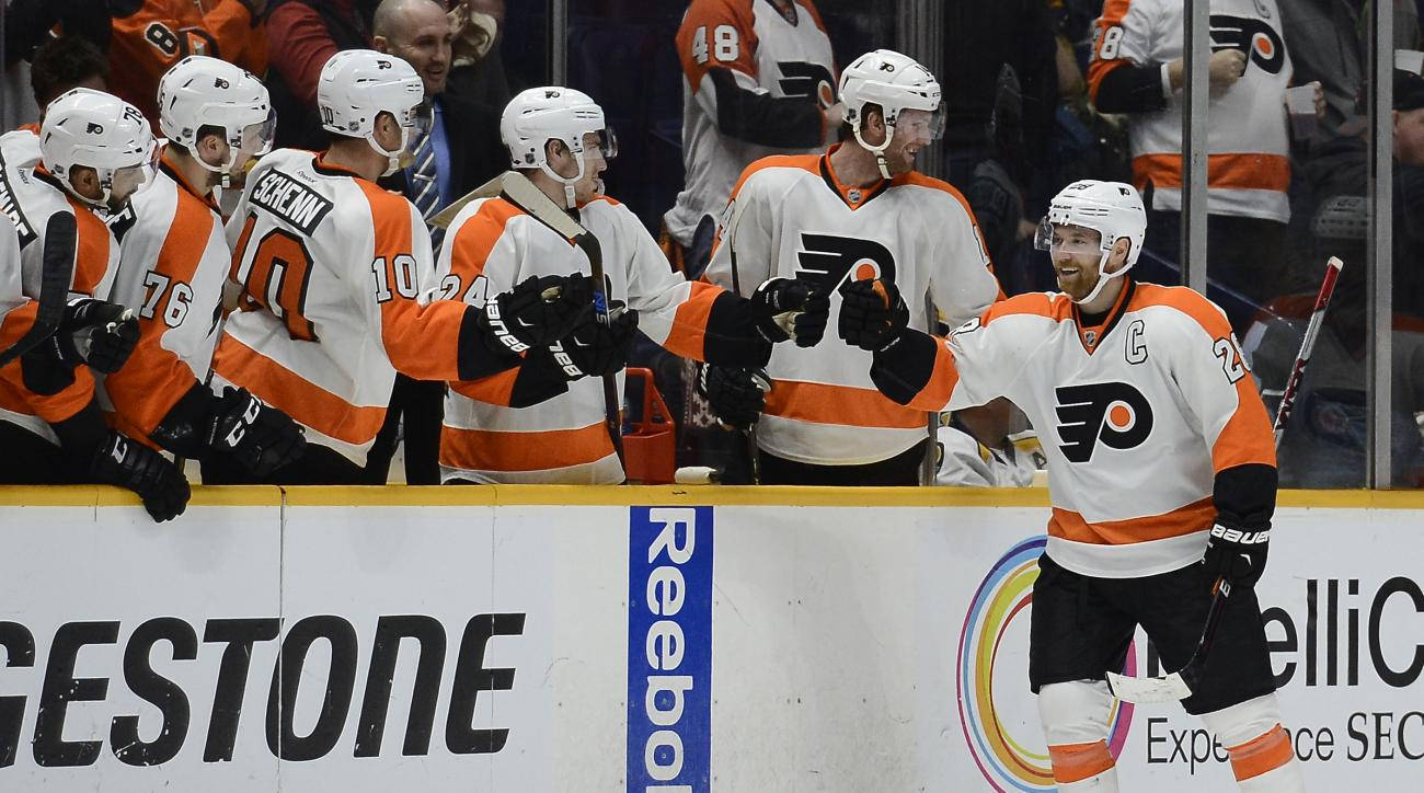 Philadelphia Flyers center Claude Giroux, right, is congratulated after scoring a goal against the Nashville Predators in the second period of an NHL hockey game Thursday, Feb. 4, 2016, in Nashville, Tenn. (AP Photo/Mark Zaleski)