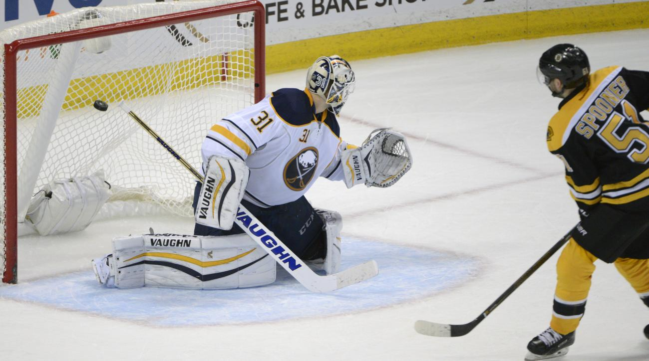 Buffalo Sabres goaltender Chad Johnson (31) gets beat by Boston Bruins center Ryan Spooner (51) as he scored the game-winning goal during the team shootout of an NHL hockey game, Thursday, Feb. 4, 2016 in Buffalo, N.Y.  Boston won 3-2. (AP Photo/Gary Wiep