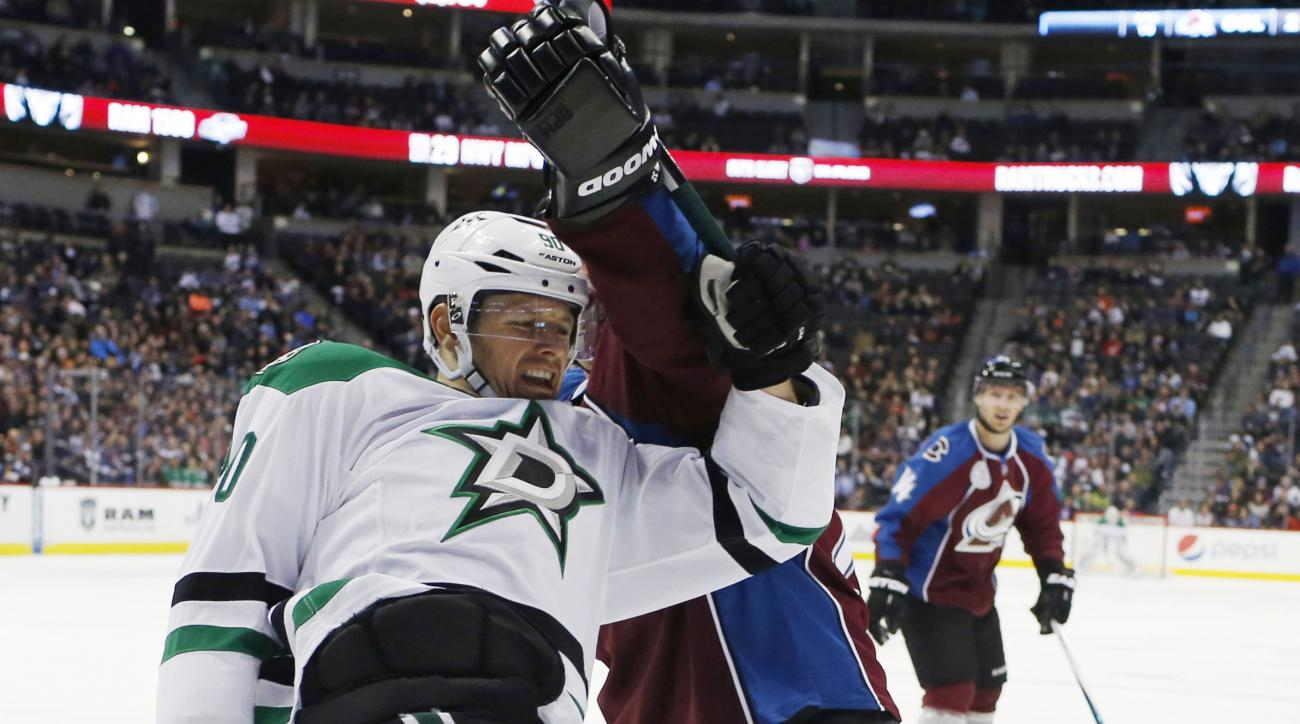 Dallas Stars center Jason Spezza, left, gets tangled up with Colorado Avalanche defenseman Francois Beauchemin as they race to control the puck in the corner in the second period of an NHL hockey game Thursday, Feb. 4, 2016, in Denver. (AP Photo/David Zal