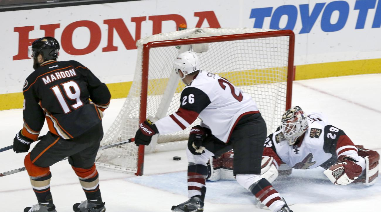 Arizona Coyotes goalie Anders Lindback can't stop a puck off Anaheim Ducks left wing Patrick Maroon (19), who scored a goal during the third period of an NHL hockey game in Anaheim, Calif., Friday, Feb. 5, 2016. The Ducks won 5-2. (AP Photo/Christine Cott