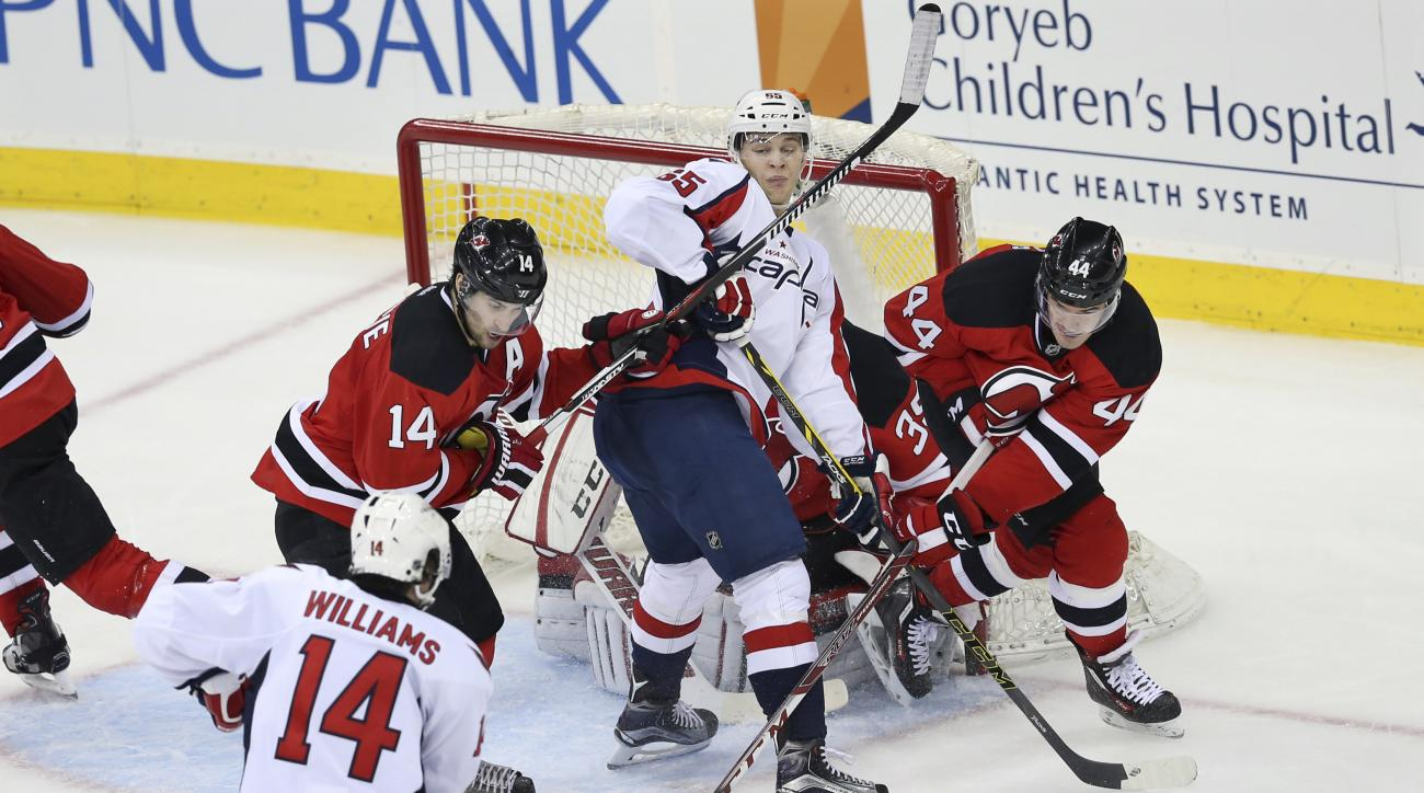 Washington Capitals left wing Andre Burakovsky (65), of Austria, sets up to score against the New Jersey Devils as he looks back for a pass from Justin Williams (14) during the second period of an NHL hockey game Saturday, Feb. 6, 2016, in Newark, N.J. (A