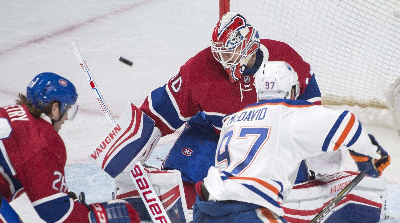 Montreal Canadiens goaltender Ben Scrivens makes a save on Edmonton Oilers' Connor McDavid (97) as Canadiens' Jeff Petry defends during the third period of an NHL hockey game in Montreal, Saturday, Feb. 6, 2016. (Graham Hughes /The Canadian Press via AP)