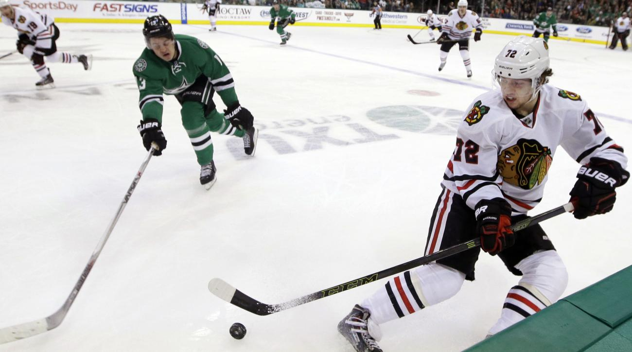 Chicago Blackhawks left wing Artemi Panarin (72) skates for the puck against Dallas Stars center Mattias Janmark (13) during the first period of an NHL hockey game Saturday, Feb. 6, 2016, in Dallas. (AP Photo/LM Otero)
