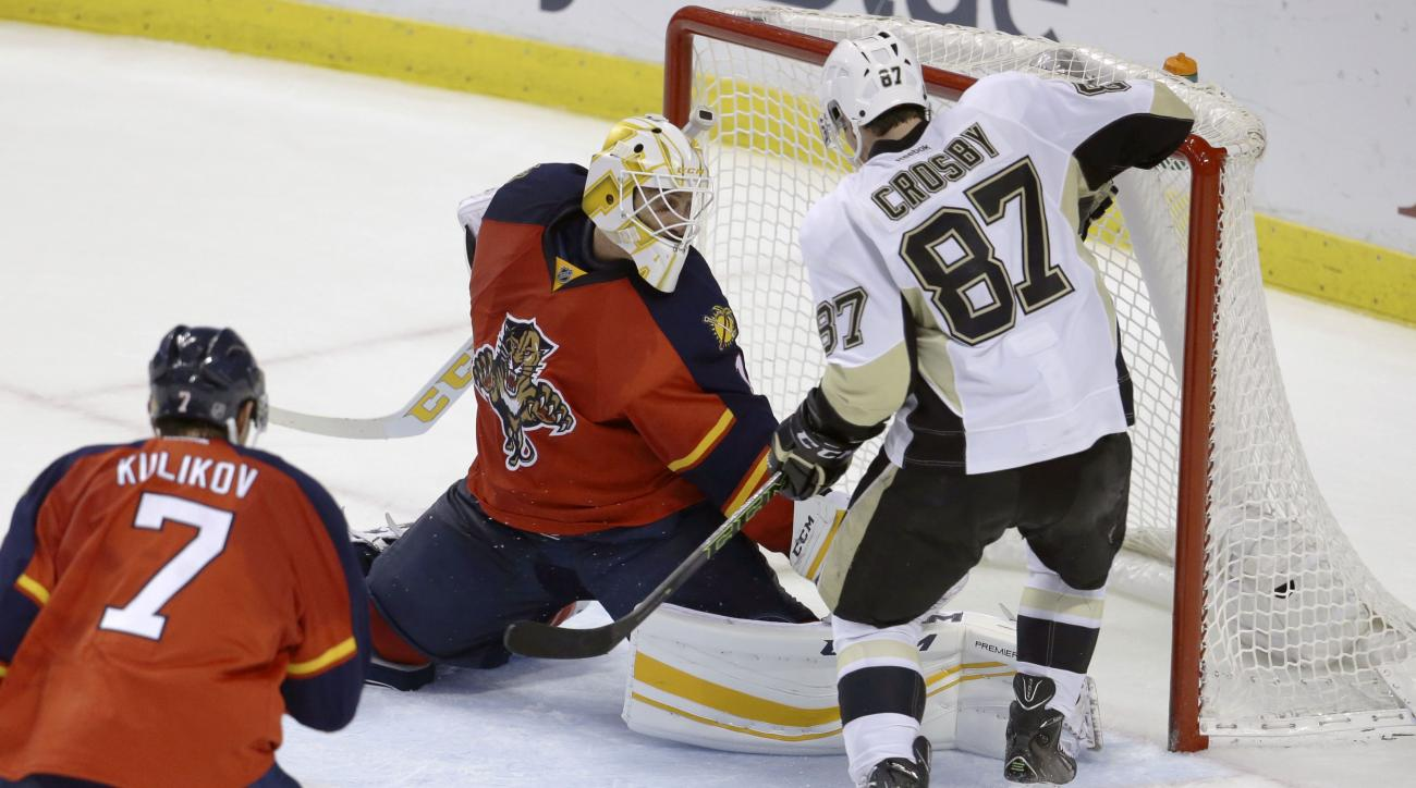 Pittsburgh Penguins center Sidney Crosby (87) scores a goal against Florida Panthers goalie Roberto Luongo, left, to tie the score during the third period of an NHL hockey game, Saturday, Feb. 6, 2016, in Sunrise, Fla. The Penguins defeated the Panthers 3