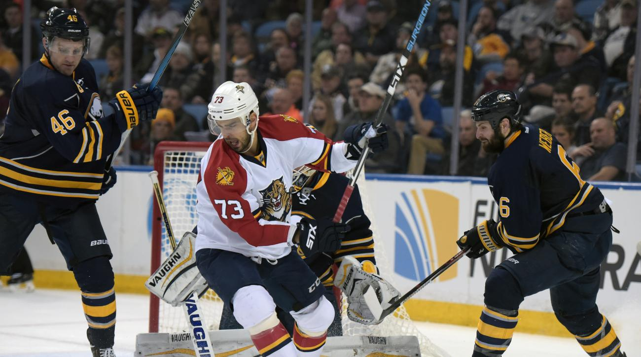 Florida Panthers' Brandon Pirri (73) battles for a loose puck as Buffalo Sabres' Cody Franson (46) and Mike Weber (6) defend during the second period of an NHL hockey game, Tuesday, Feb. 9, 2016 in Buffalo, N.Y. (AP Photo/Gary Wiepert)