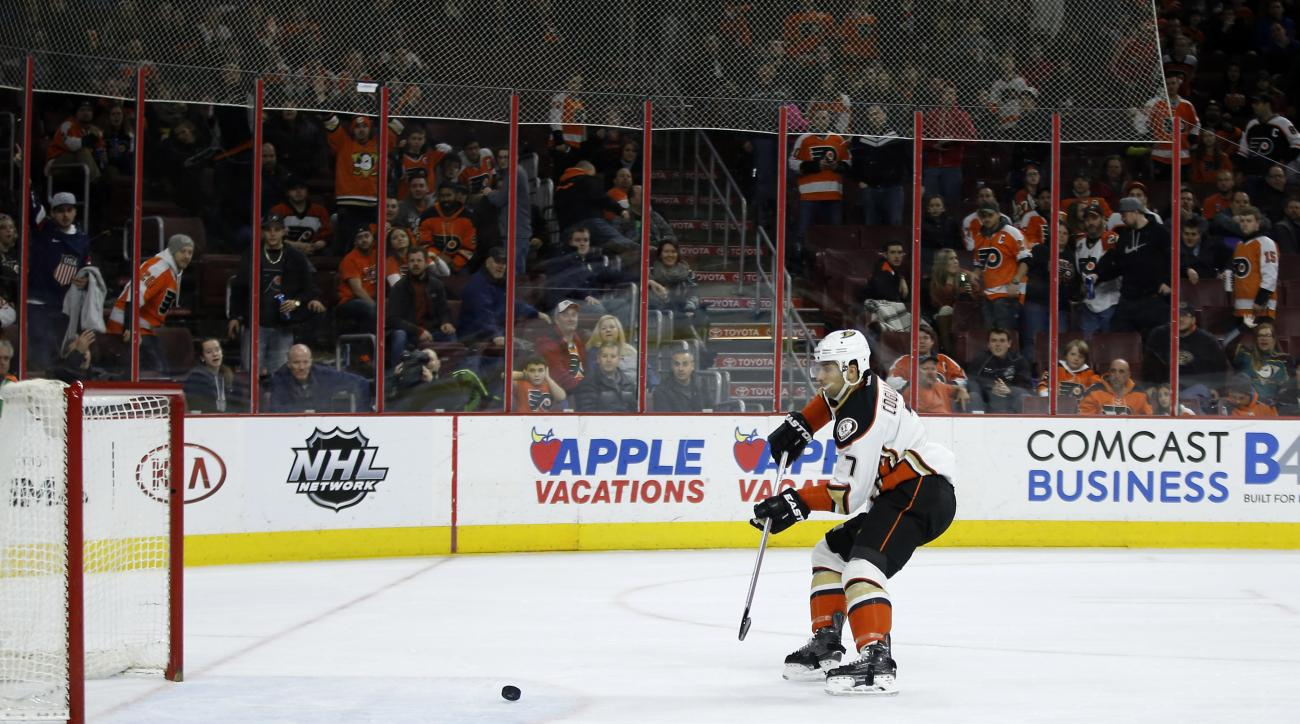 Anaheim Ducks' Andrew Cogliano scores an empty-net goal during the third period of an NHL hockey game against the Philadelphia Flyers, Tuesday, Feb. 9, 2016, in Philadelphia. Anaheim won 4-1. (AP Photo/Matt Slocum)