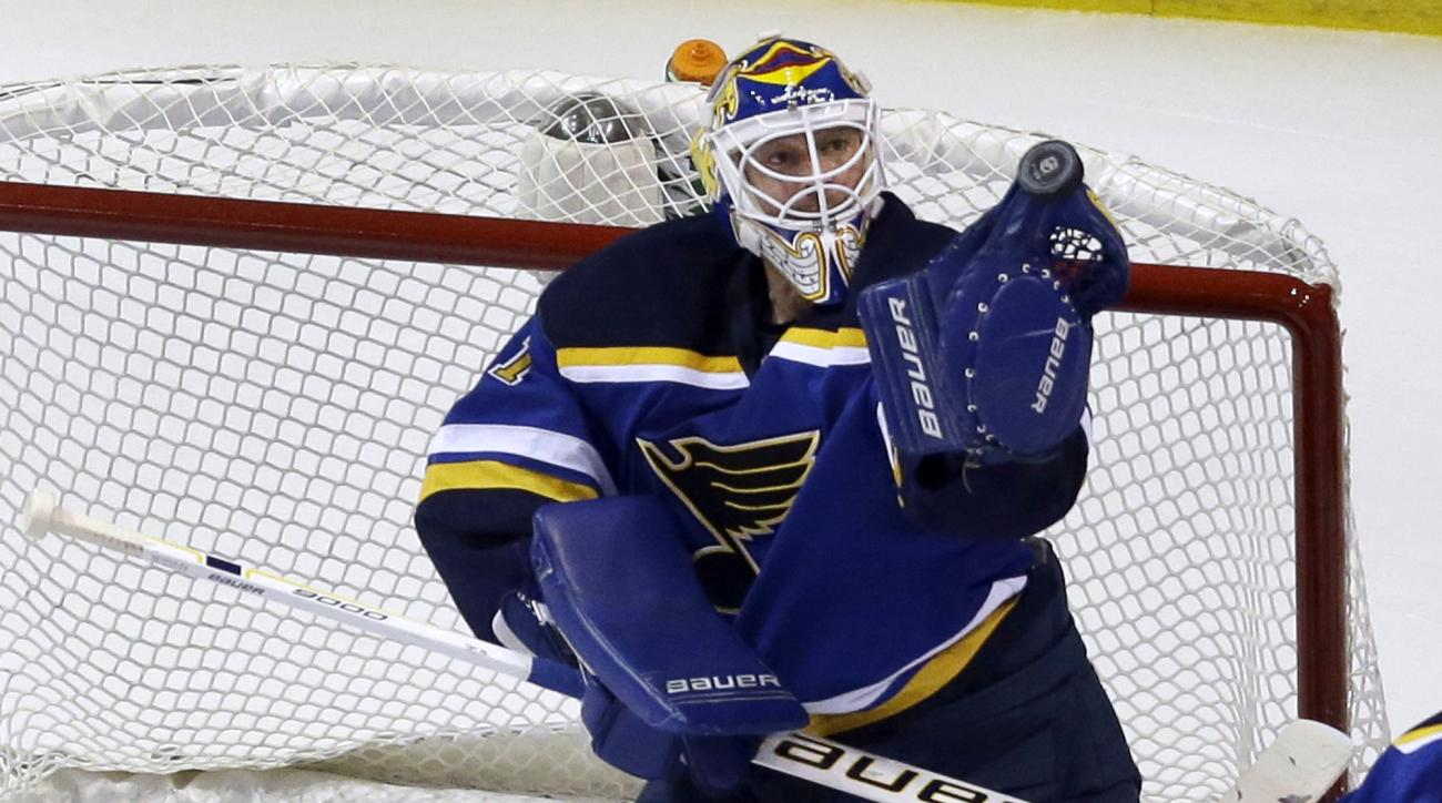 St. Louis Blues goalie Brian Elliott is unable to control the puck during the second period of an NHL hockey game against the Winnipeg Jets Tuesday, Feb. 9, 2016, in St. Louis. After Elliott lost control, Jet's Bryan Little was able to knock the puck in f