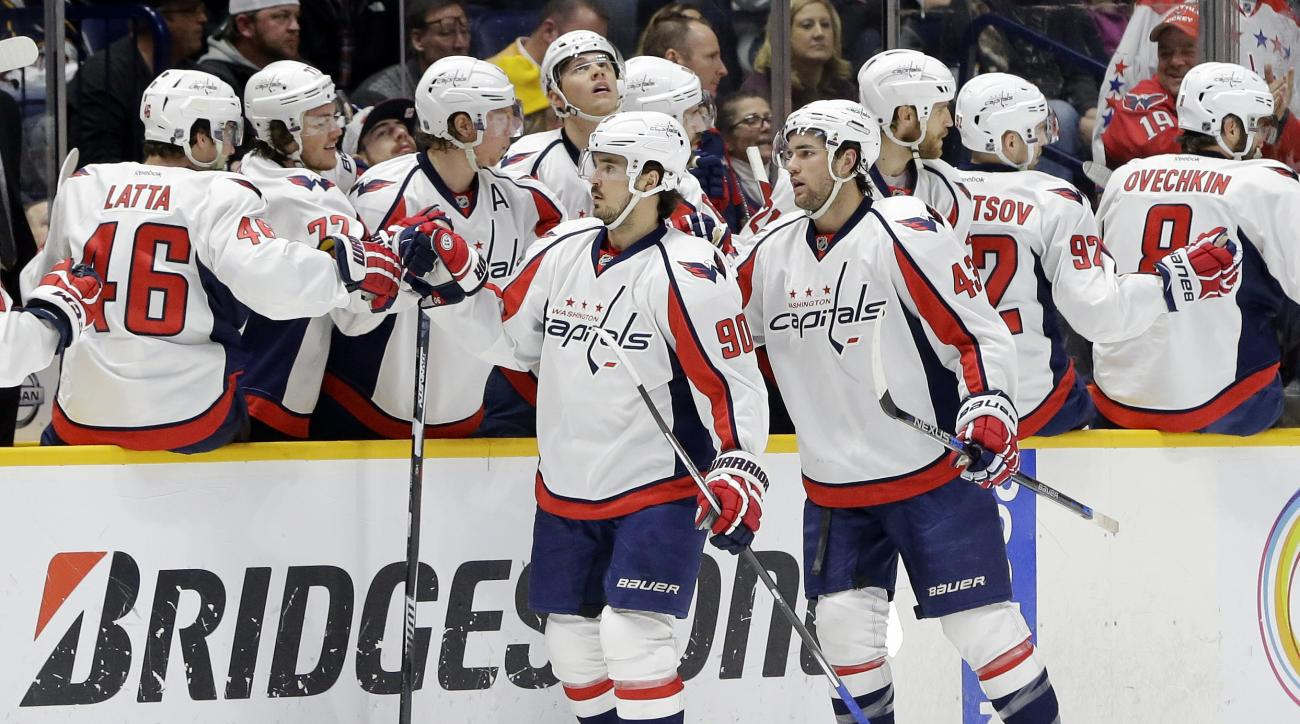 Washington Capitals right wing Tom Wilson (43) is congratulated by teammates after scoring a goal against the Nashville Predators in the second period of an NHL hockey game Tuesday, Feb. 9, 2016, in Nashville, Tenn. Ahead of Wilson is forward Marcus Johan