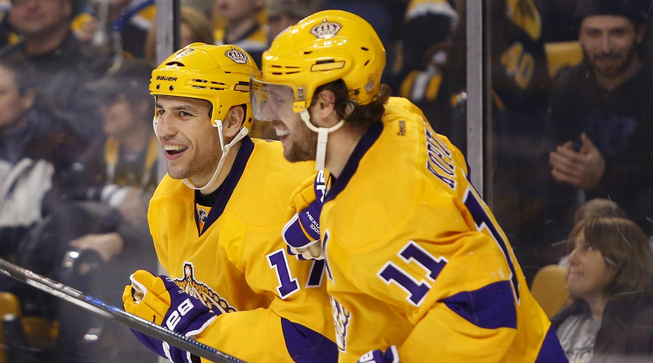 Los Angeles Kings' Milan Lucic celebrates his goal with teammate Anze Kopitar (11) during the third period of the Los Angeles Kings 9-2 win over the Boston Bruins in an NHL hockey game in Boston Tuesday, Feb. 9, 2016. (AP Photo/Winslow Townson)