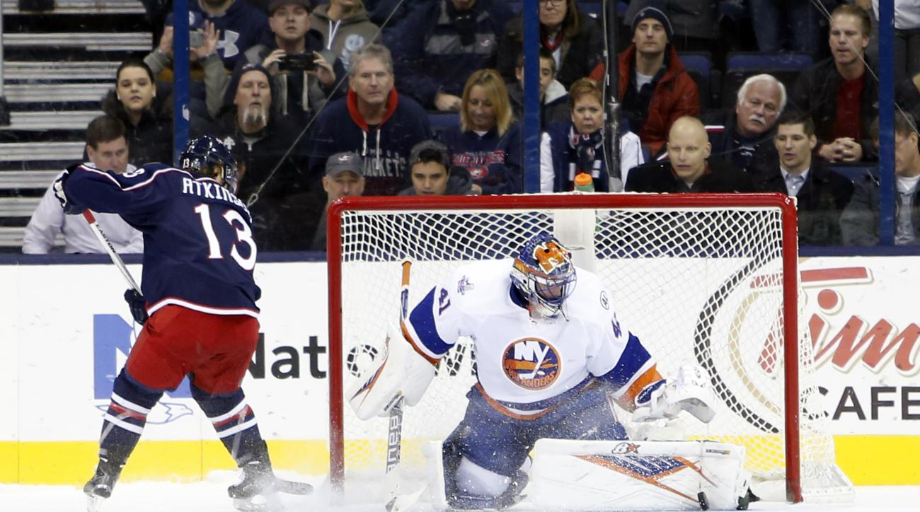 New York Islanders' Jaroslav Halak, right, of Slovakia, makes a save against Columbus Blue Jackets' Cam Atkinson during the shootout of an NHL hockey game Tuesday, Feb. 9, 2016, in Columbus, Ohio. The Islanders beat the Blue Jackets 3-2 in shootout. (AP P