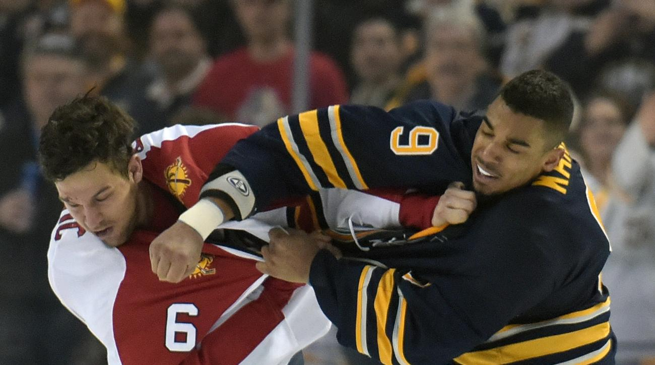 Florida Panthers defenseman Alex Petrovic (6) gets into a fight for the third time in the game with Buffalo Sabres left winger Evander Kane (9) during the third period of an NHL hockey game, Tuesday, Feb. 9, 2016 in Buffalo, N.Y.  Florida won 7-4. (AP Pho