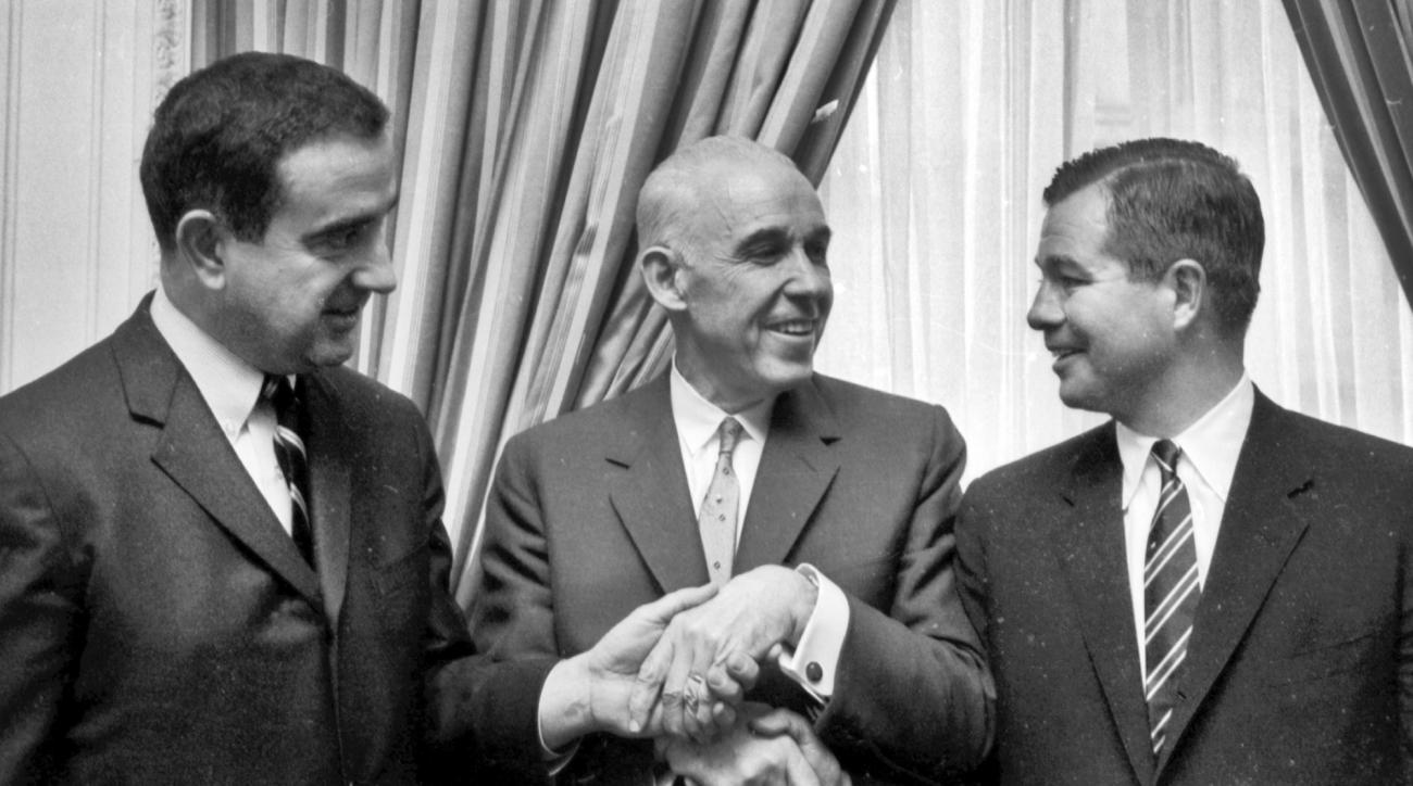 FILE - In this Feb. 9,1966, file photo, Clarence Campbell, center, president of the National Hockey League, shakes hands with George Flaherty, of San Francisco, left, and Gordon Ritz, of Minneapolis-St. Paul, after they were awarded franchises in the leag