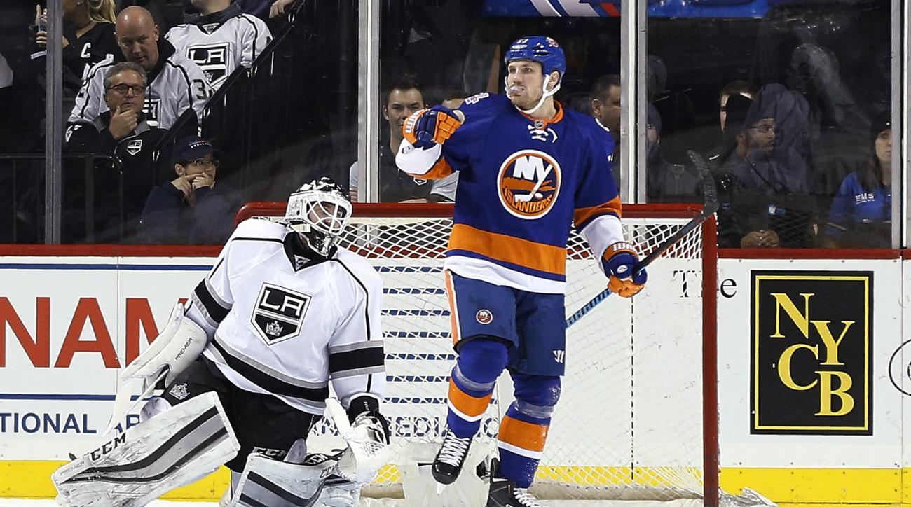 Los Angeles Kings goalie Jhonas Enroth, left, reacts after giving up a goal to New York Islanders center Casey Cizikas (53) during the first period of an NHL hockey game Thursday, Feb. 11, 2016, in New York. (AP Photo/Julie Jacobson)