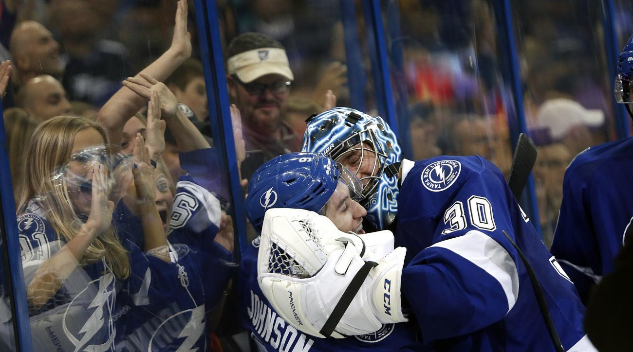 Tampa Bay Lightning center Tyler Johnson (9) celebrates his goal with goalie Ben Bishop (30) during overtime of an NHL hockey game against the Nashville Predators, Friday, Feb. 12, 2016, in Tampa, Fla. (AP Photo/Brian Blanco)