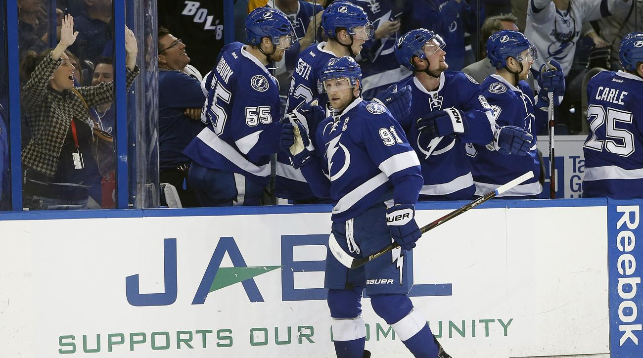 Tampa Bay Lightning center Steven Stamkos (91) celebrates with teammates after scoring against the Nashville Predators during the third period of an NHL hockey game Friday, Feb. 12, 2016, in Tampa, Fla. (AP Photo/Brian Blanco)