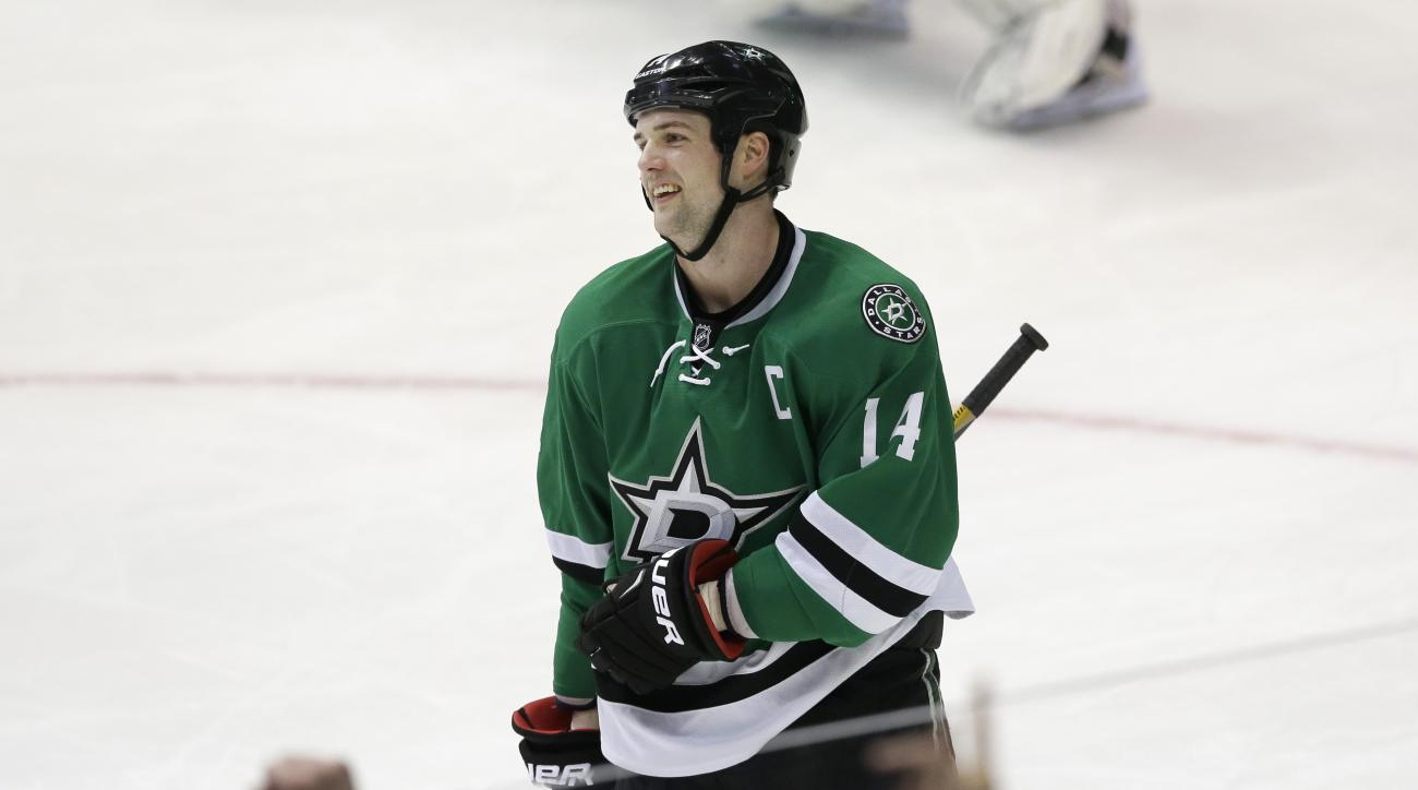 Dallas Stars left wing Jamie Benn (14) reacts to scoring a goal during the second period of an NHL hockey game against the Washington Capitals Saturday, Feb. 13, 2016, in Dallas. (AP Photo/LM Otero)