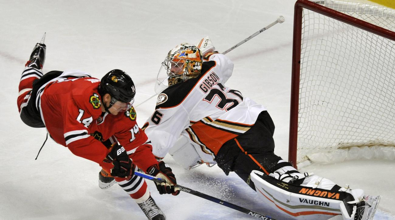 Anaheim Ducks goalie John Gibson (36), makes a save against Chicago Blackhawks' Richard Panik (14), of Slovakia, during the second period of a hockey game Saturday, Feb. 13, 2016, in Chicago. (AP Photo/Paul Beaty)