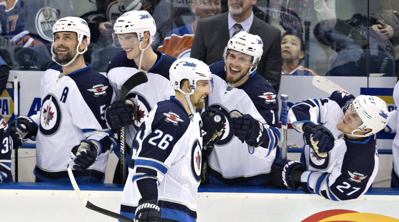 Winnipeg Jets' Blake Wheeler (26) celebrates a shootout goal against the Edmonton Oilers during an NHL hockey game Saturday, Feb. 13, 2016, in Edmonton, Alberta. Winnipeg won 2-1. (Jason Franson/The Canadian Press via AP)