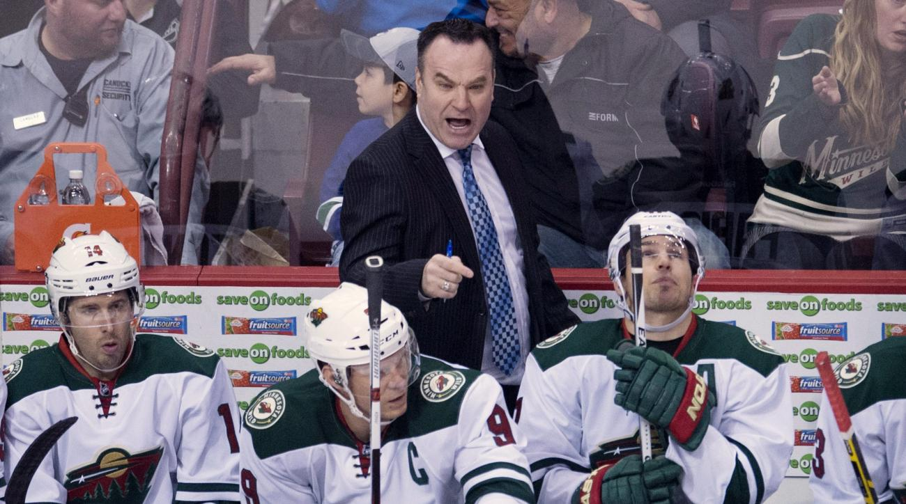 Minnesota Wild interim coach John Torchetti is seen during first period NHL action against the Vancouver Canucks in Vancouver, Canada, Monday, Feb. 15, 2016. (Jonathan Hayward/The Canadian Press via AP) MANDATORY CREDIT