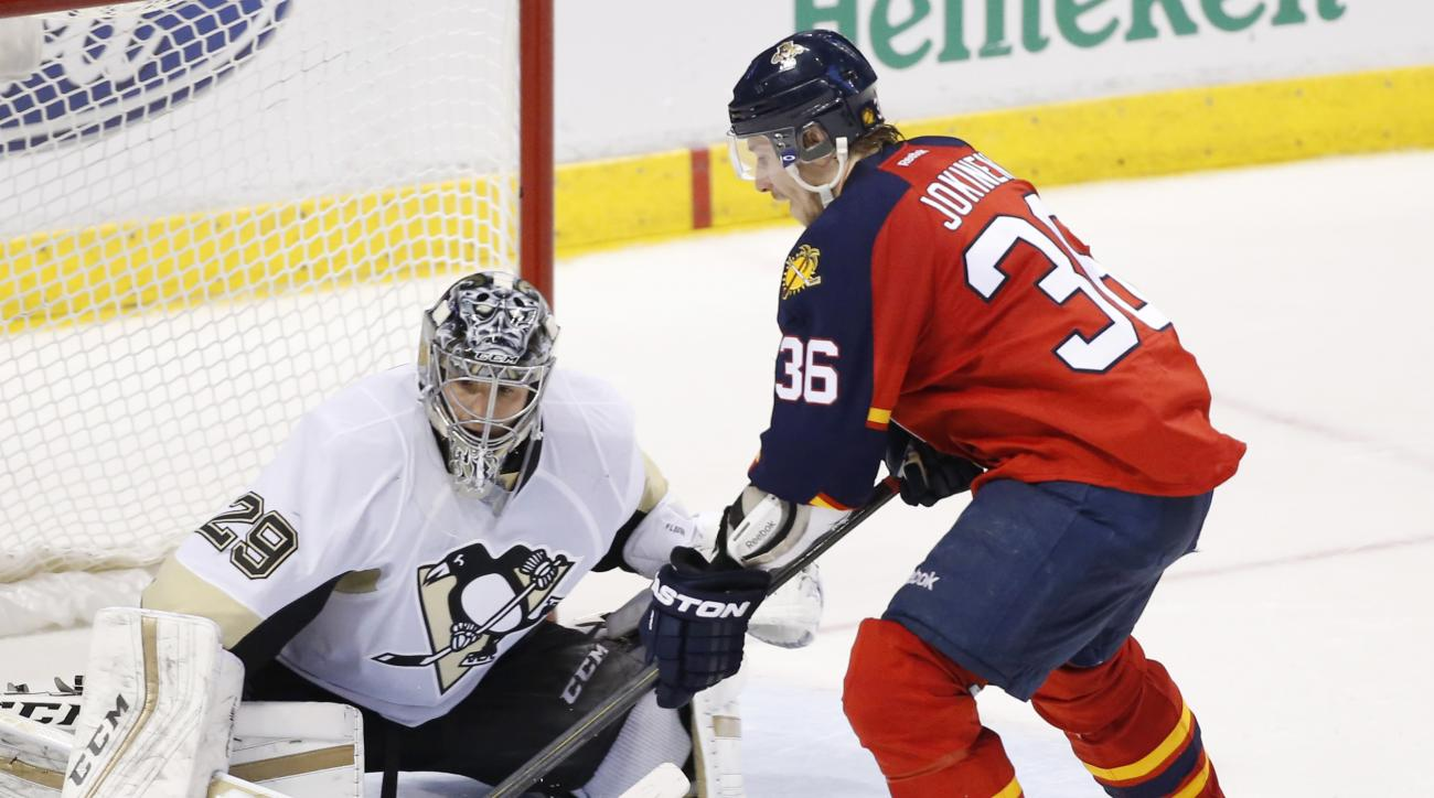 Florida Panthers left wing Jussi Jokinen (36) shoots the winning shot during a shootout against Pittsburgh Penguins goalie Marc-Andre Fleury (29) in an NHL hockey game, Monday, Feb. 15, 2016 in Sunrise, Fla. The Panthers defeated the Penguins 2-1. (AP Pho