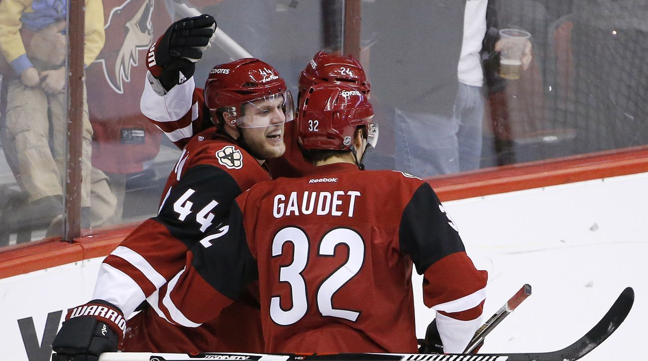 Arizona Coyotes' Kevin Connauton (44) celebrates his goal against the Montreal Canadiens with Tyler Gaudet (32) and Kyle Chipchura during the second period of an NHL hockey game Monday, Feb. 15, 2016, in Glendale, Ariz. (AP Photo/Ross D. Franklin)