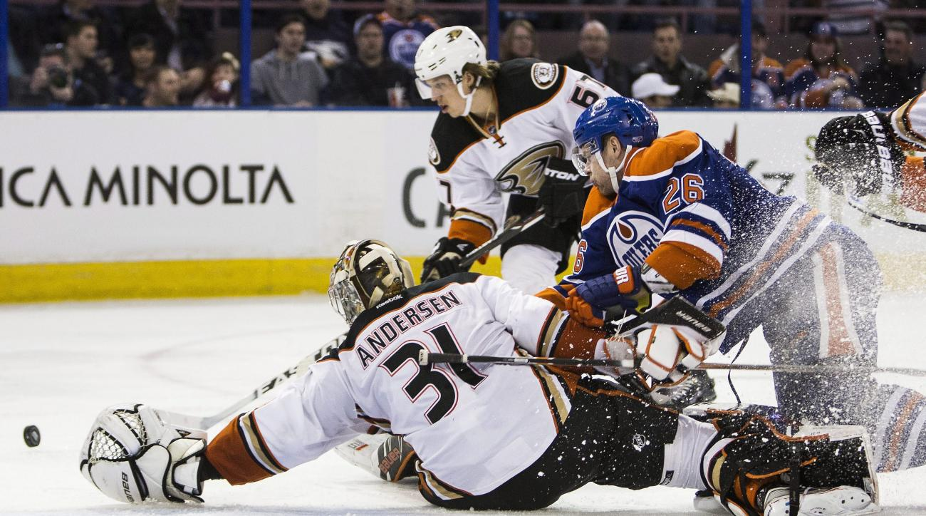 Anaheim Ducks' goalie Frederik Andersen (31) reaches back for the puck as Edmonton Oilers' Iiro Pakarinen (26) looks for a shot during the second period of an NHL hockey game, Tuesday, Feb. 16, 2016 in Edmonton, Alberta. (Codie McLachlan/The Canadian Pres