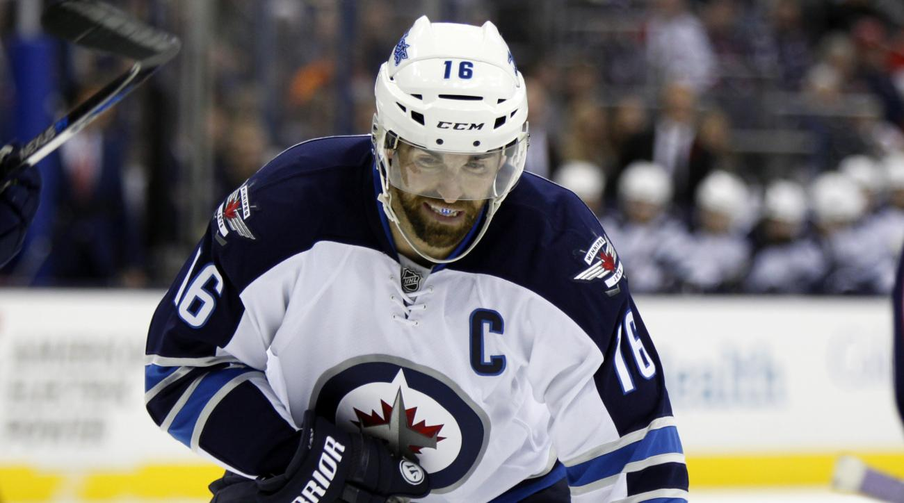 FILE - In this Oct. 31, 2015, file photo, Winnipeg Jets' Andrew Ladd is shown during an NHL hockey game against Columbus Blue Jackets  in Columbus, Ohio. Ladd is among the best players expected to be available at the NHL trade deadline. (AP Photo/Paul Ver
