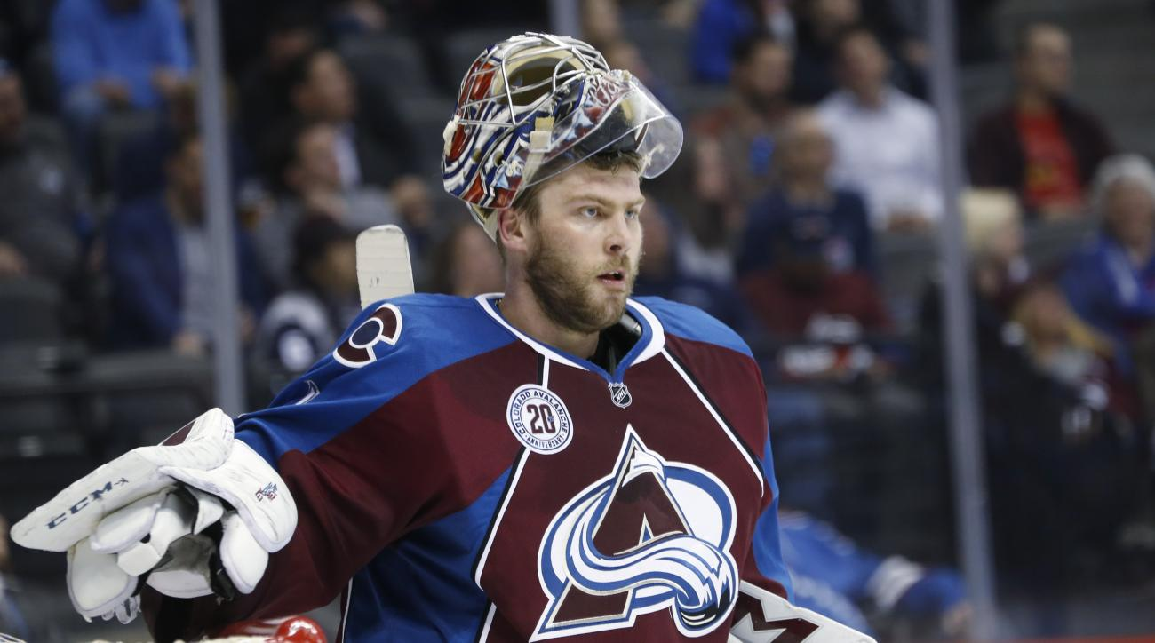Colorado Avalanche goalie Semyon Varlamov, of Russia, reacts after giving up a goal to the Montreal Canadiens in the second period of an NHL hockey game Wednesday, Feb. 17, 2016, in Denver. (AP Photo/David Zalubowski)