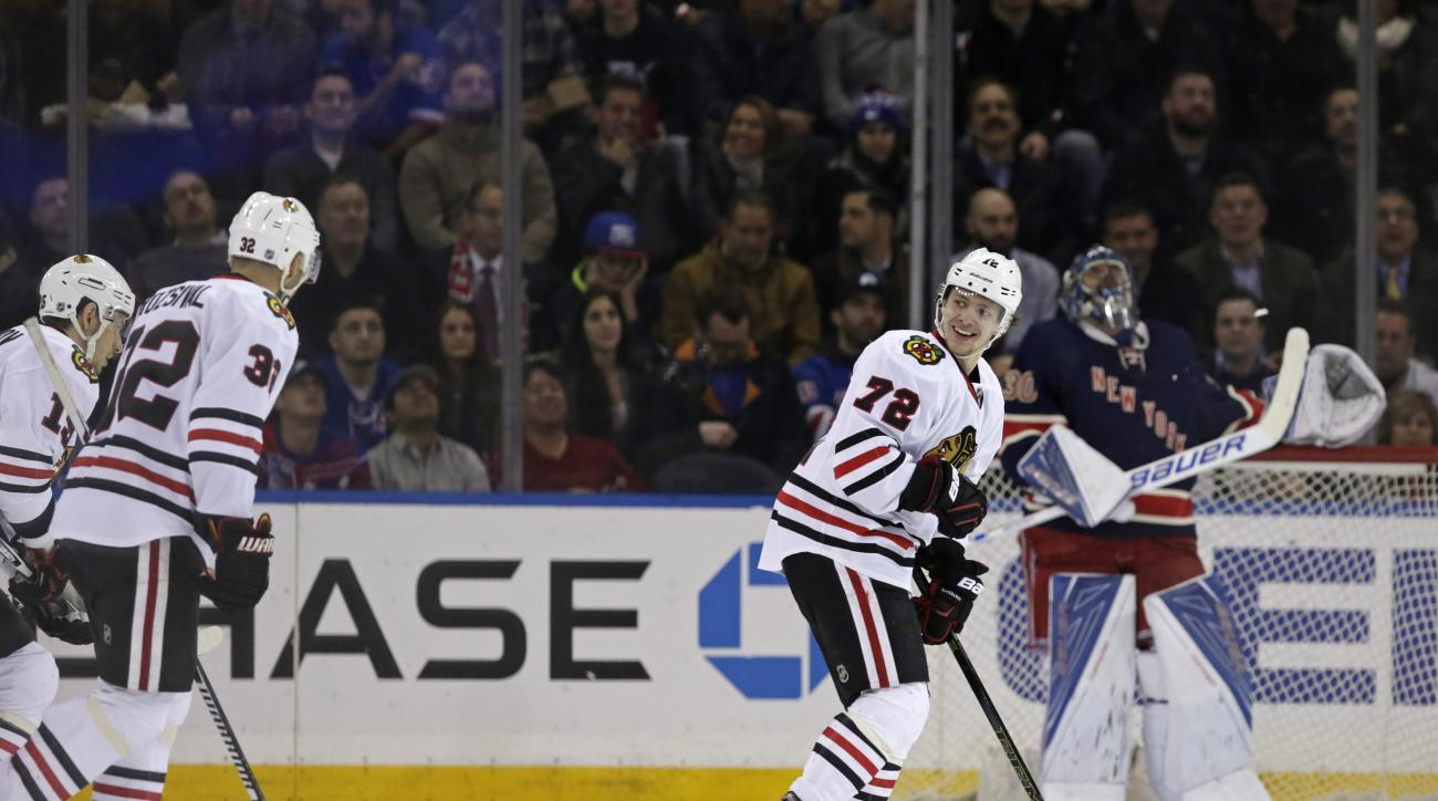 Chicago Blackhawks left wing Artemi Panarin (72) reacts after scoring a goal on New York Rangers goalie Henrik Lundqvist during the second period of an NHL hockey game Wednesday, Feb. 17, 2016, in New York. (AP Photo/Adam Hunger)