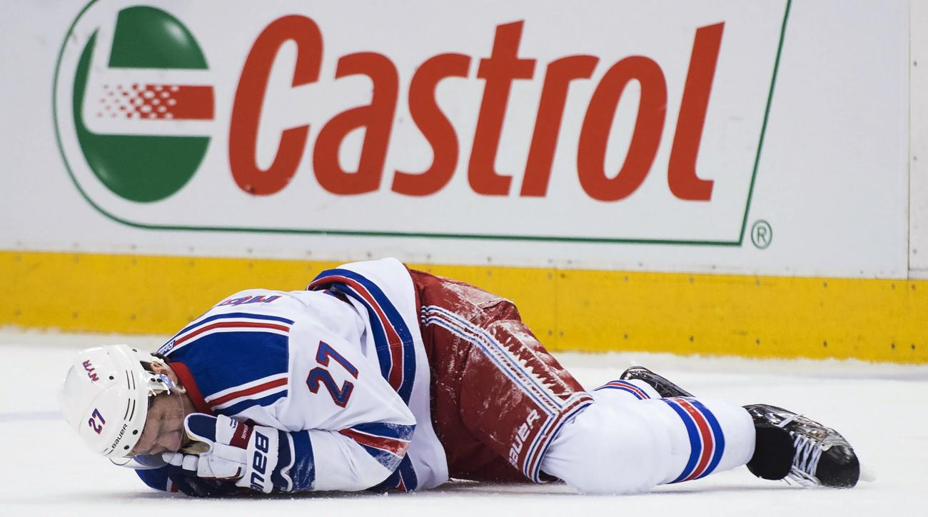 New York Rangers defenseman Ryan McDonagh (27) lies injured on the ice after taking a hit to the head from Toronto Maple Leafs center Leo Komarov during the first period of an NHL hockey game Thursday, Feb. 18, 2016, in Toronto. (Nathan Denette/The Canadi