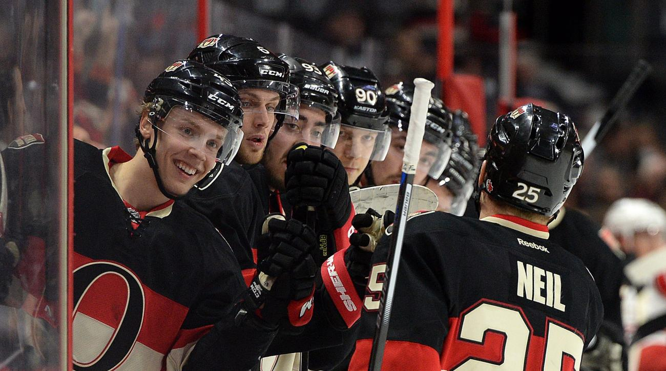 Ottawa Senators' Chris Neil gets high-fives from his teammates after an assist on a goal by Senators' Zack Smith, not shown, during the second period of an NHL hockey game, Thursday, Feb. 18, 2016 in Ottawa, Ontario.  (Sean Kilpatrick/The Canadian Press v